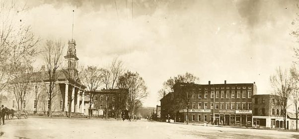 McConnelsville, Ohio in 1880s. The Greek-Revival Courthouse (left) was built in 1863; the McConnelsville Bank (right) opened in 1863.